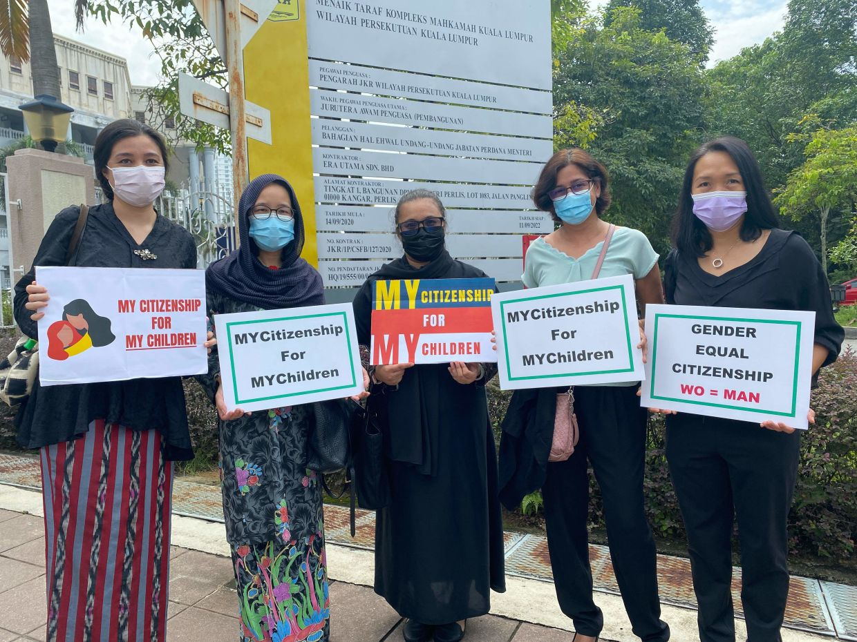 A filepic of NGO Family Frontiers president Suri Kempe (left) with plaintiffs in the case challenging a law preventing women in Malaysia passing their citizenship on to children born overseas, posing outside the Kuala Lumpur High Court. Photo: Family Frontiers/AFP