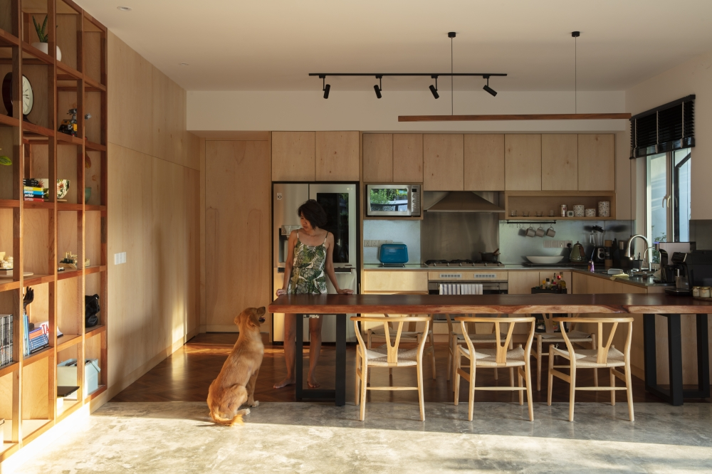 For his home, he likes raw, natural finished materials.