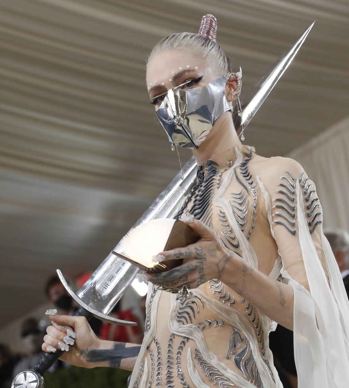 Grimes carrying a sword on the red carpet. Photo: Reuters