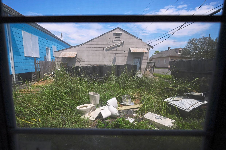Debris is seen in the yard of Kemp's rental home in the aftermath of Hurricane Ida.