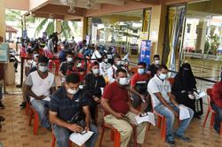 Foreigners join locals for jabs on last day of Movak 2.0 programme