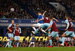 Soccer-Everton hit back in style to beat Burnley