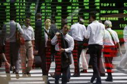 Asia shares mixed, dollar steady ahead of US inflation