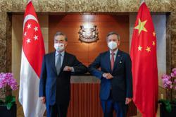 Chinese FM meets DPM Heng, Vivian during working visit to Singapore