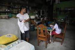 Philippines logs 18,056 new Covid-19 cases, Manila placed under second-highest level lockdown