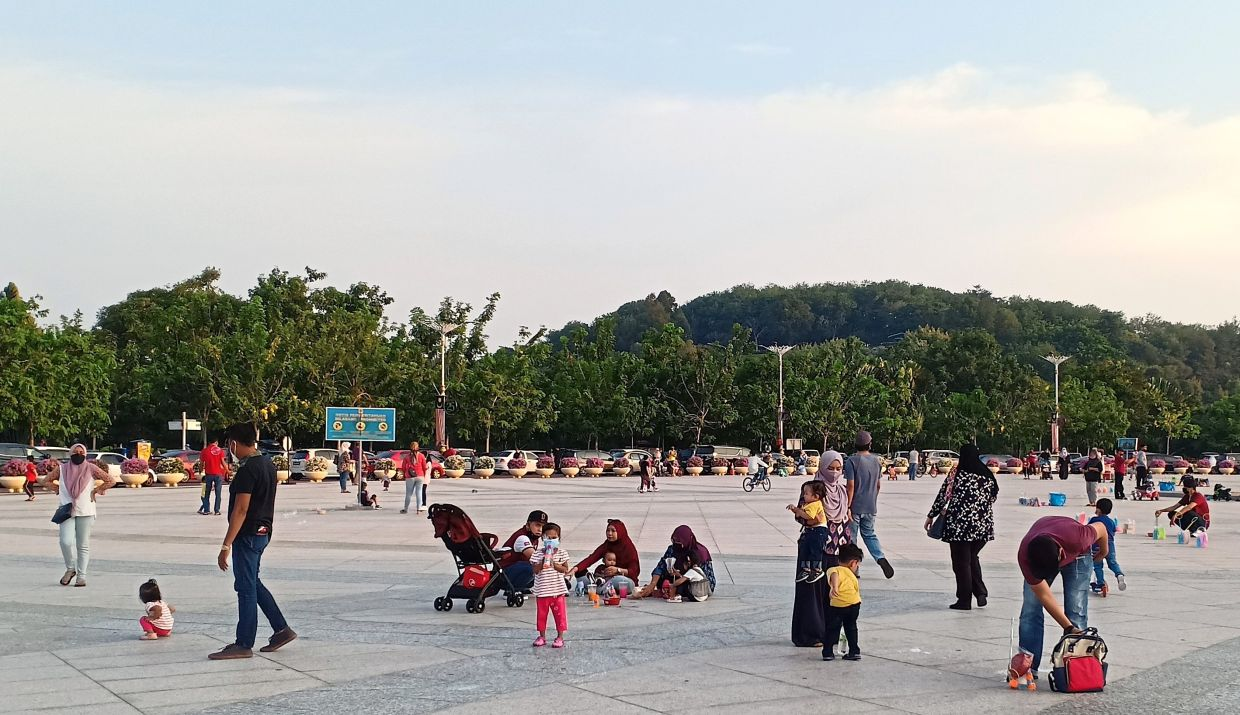 Most of those seen at Dataran Putra in Putrajaya over the weekend were families who came with their little ones in tow to enjoy the fresh air after the Klang Valley entered Phase Two of the National Recovery Plan. — FARID WAHAB/The Star