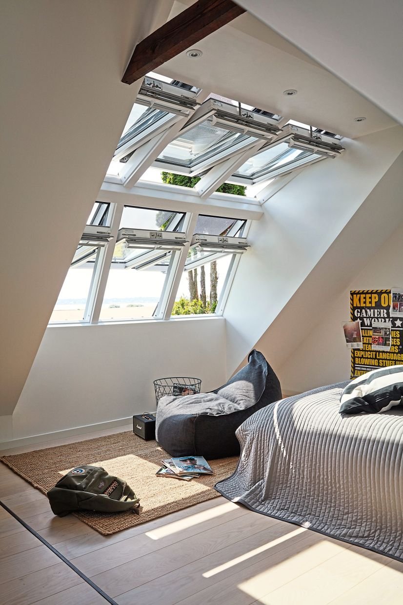 Heat protection in the form of the right window glass is an important investment towards making sure your attic doesn't feel like a sauna. Photo: Velux/dpa