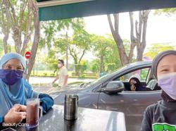 Student joins family for dine-in from the car