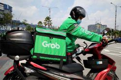 Grab cuts full-year outlook on Delta variant