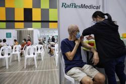 Singapore kicks off Covid-19 vaccine booster programme