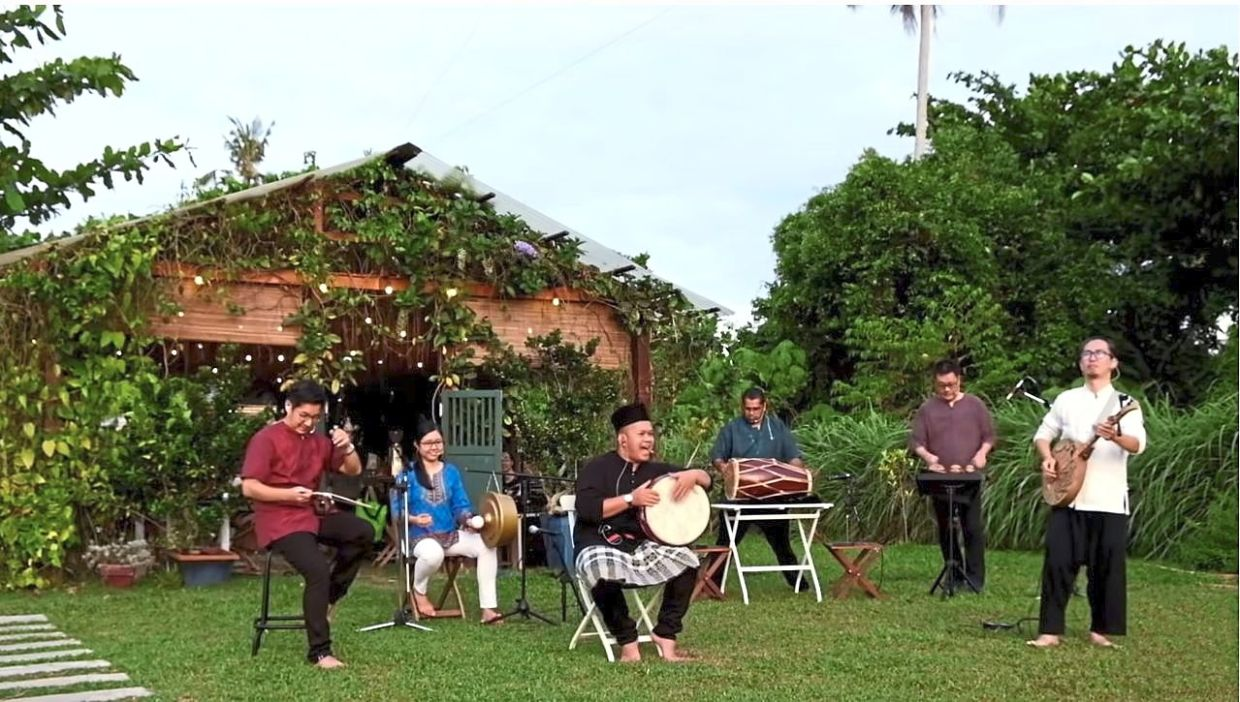 Showcase of culture: A screencap from YouTube showing Culture Shot performing their hit titled 'Song of the Streets' at a farm in Balik Pulau, Penang.
