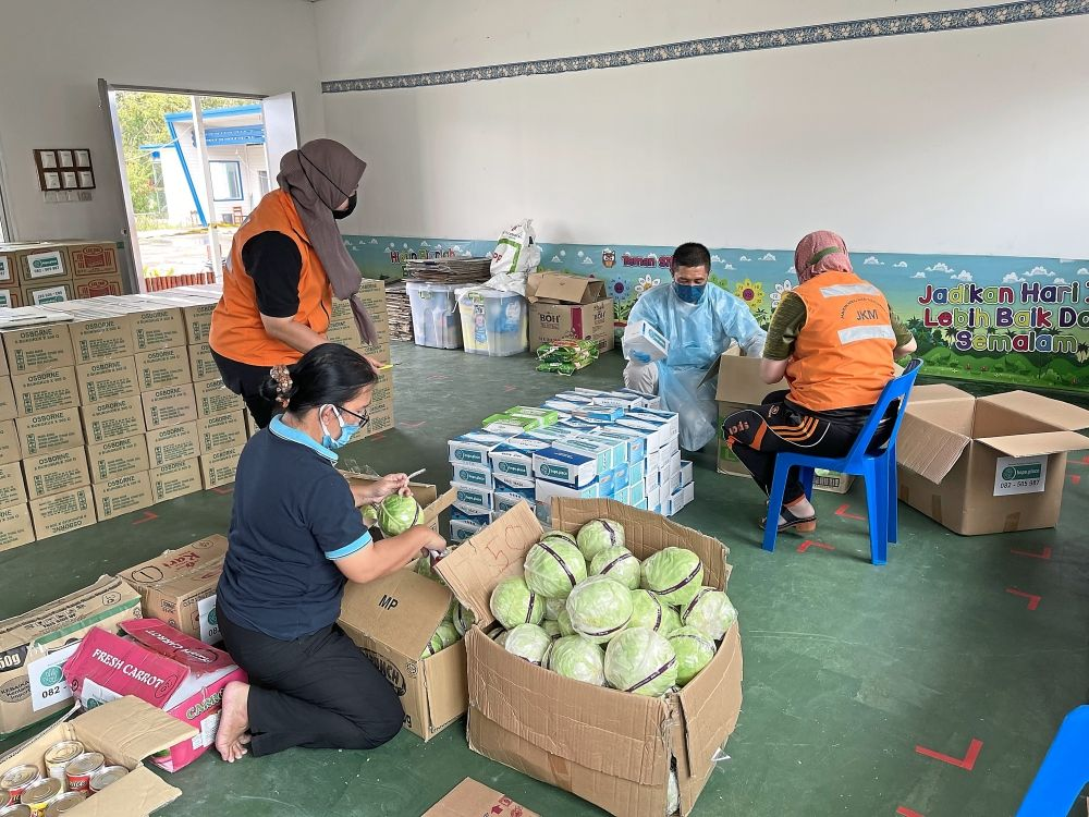 The Hope Place team sorting out rations to be given to people in need.
