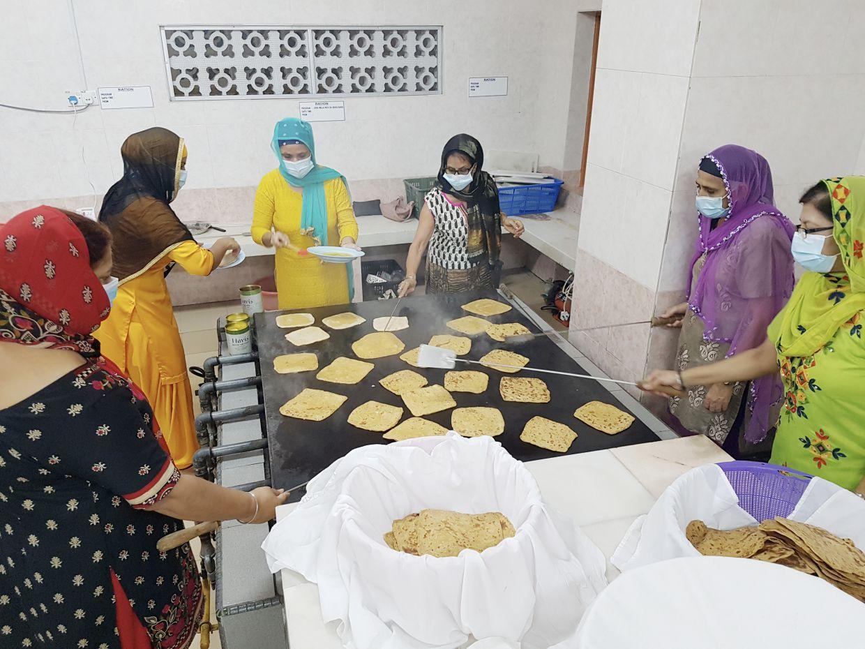 Volunteers at Gurdwara Sahib Seremban cooking for the local community