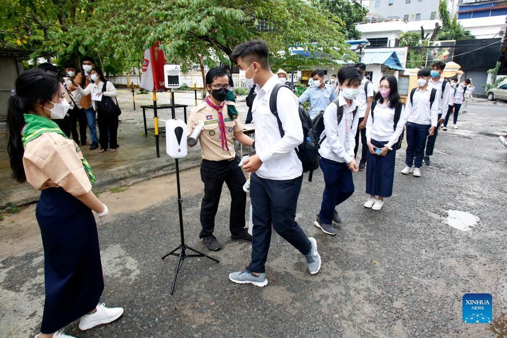 Students queue for body temperature screening at the Preah Sisowath High School in Phnom Penh, Cambodia, Wednesday (Sept. 15, 2021). - Xinhua