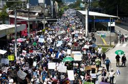 Thousands of Salvadorans march against President Bukele
