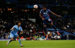 Soccer-Man City survive Nkunku hat-trick to overwhelm Leipzig 6-3