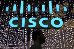 Cisco forecasts growth from software shift, but chip prices pressure profits