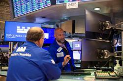 Global shares edge higher on Wall Street strength