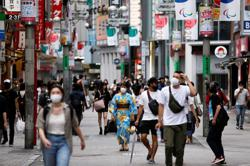 Japan cuts economic view on weaker production, spending due to Covid revival