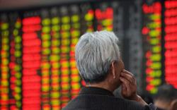 China stocks down over 1% on Evergrande fallout fears