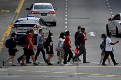 910 new Covid-19 cases in Singapore, highest since last May; one unvaccinated woman dies