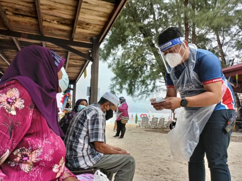 Islanders at Pulau Mantanani off Sabah's north western Kota Belud district receiving the single dose of the CanSino vaccine.