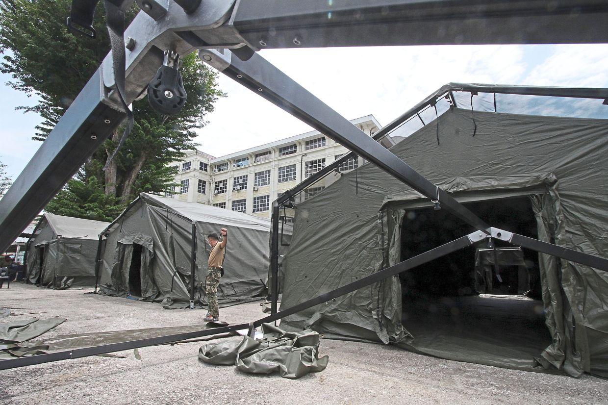 Some of the tents with the framework partially completed at the field hospital site.