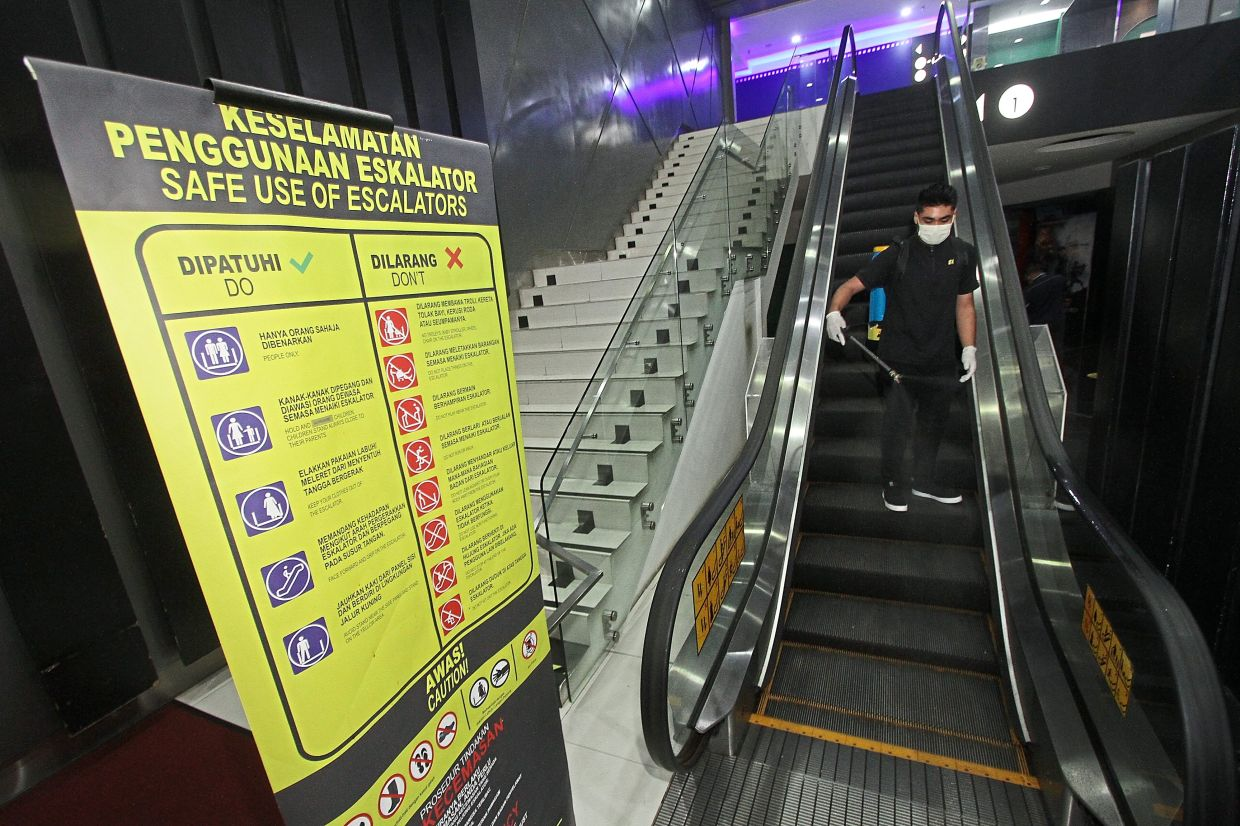 The escalator handrails and steps are often sanitised.