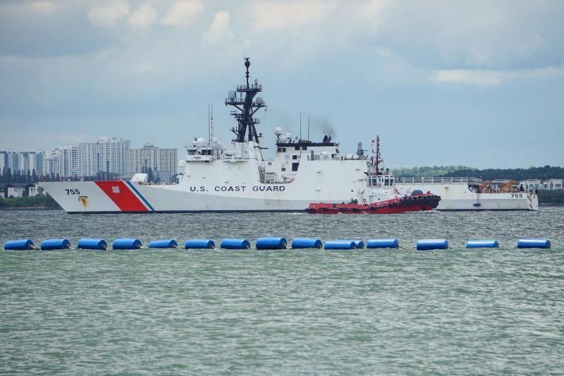 A US Coast Guard vessel plies along the Johor Strait bordering Singapore on Thursday, Sept 16, 2021. - AFP