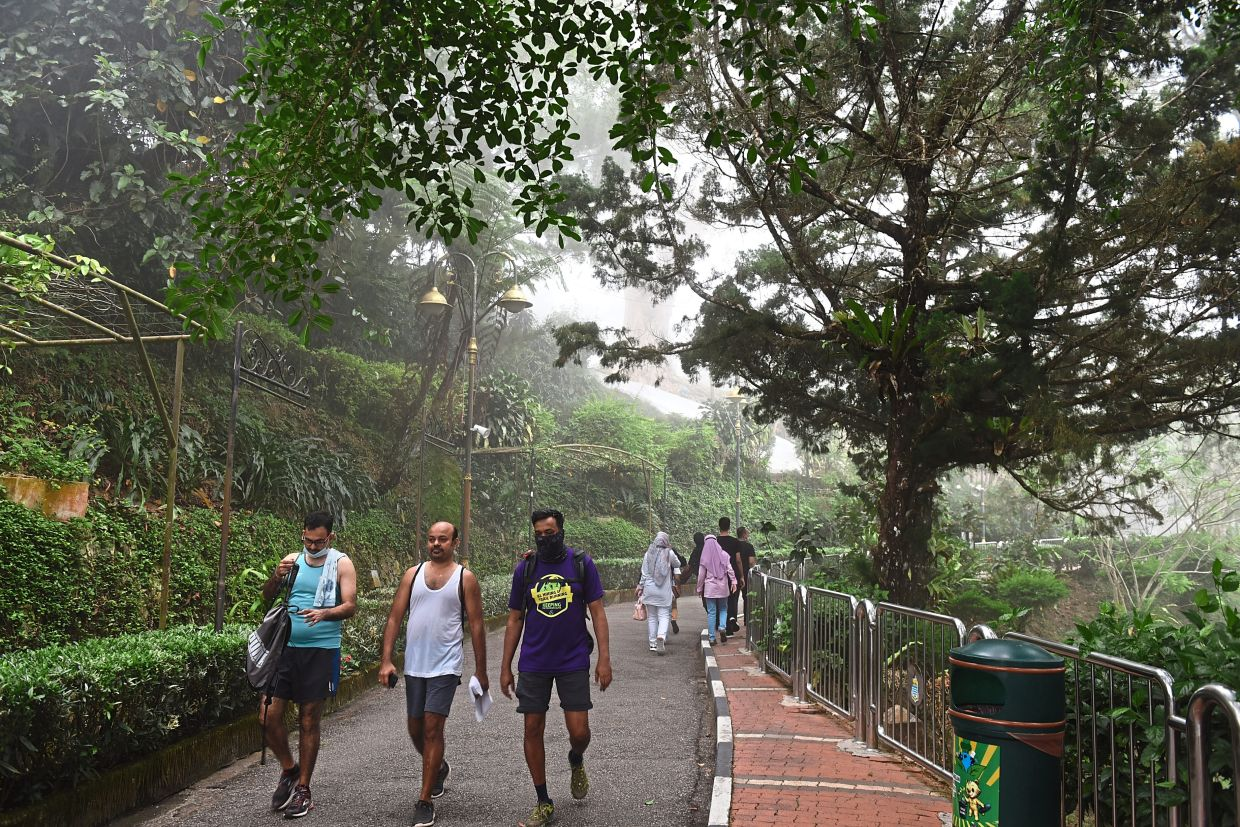 Visitors throng the scenic routes of Penang Hill.