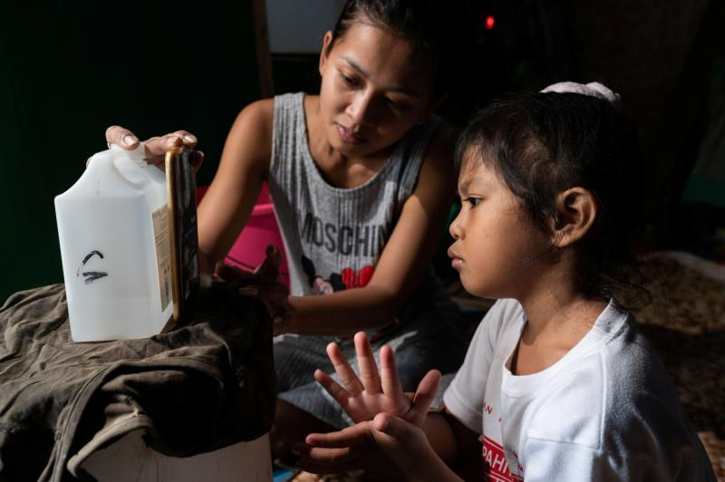 Kindergarten student Chesca Rumbines attends online classes from her home, as face-to-face classes are yet to resume amid coronavirus disease (Covid-19), in Manila, Philippines, on Thursday, September 16, 2021. - Reuters