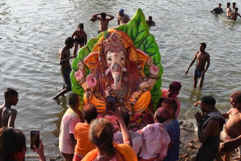 Hindu devotees carry an idol of the elephant-headed Hindu god Ganesha for an immersion during the ten-day-long Ganesh Chaturthi festival along a river on the outskirts of Amritsar on Thursday, September 16, 2021. - AFP