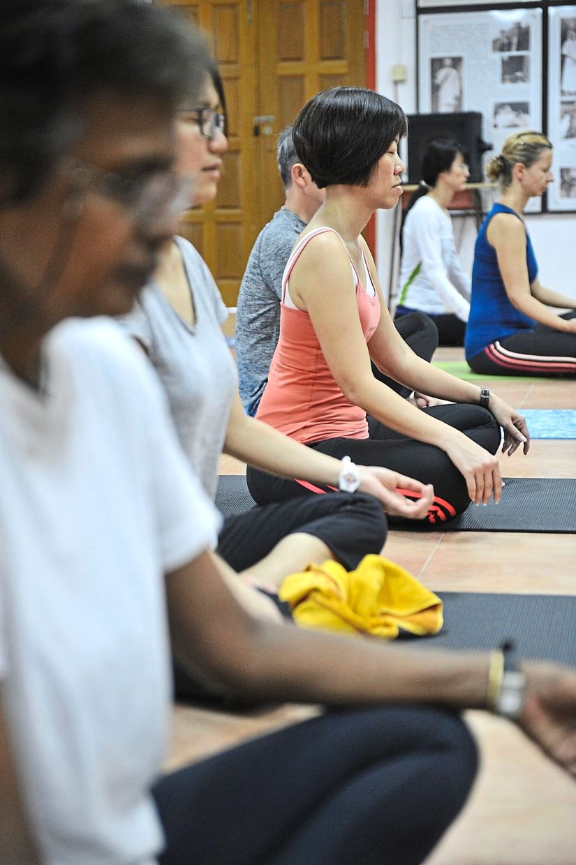 Practising yoga can help relieve menopausal symptoms, as well as improve strength and coordination. — Photos: Filepic