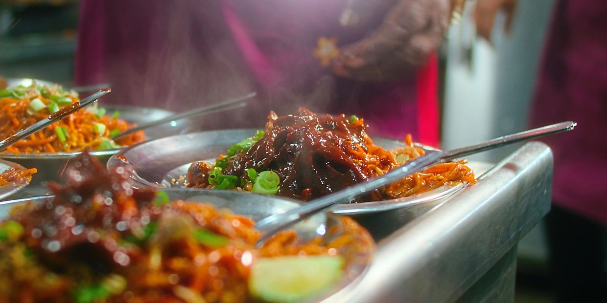 The documentary uncovers interesting stories about the origins of dishes like mee sotong, which was created based on a challenge from a customer.