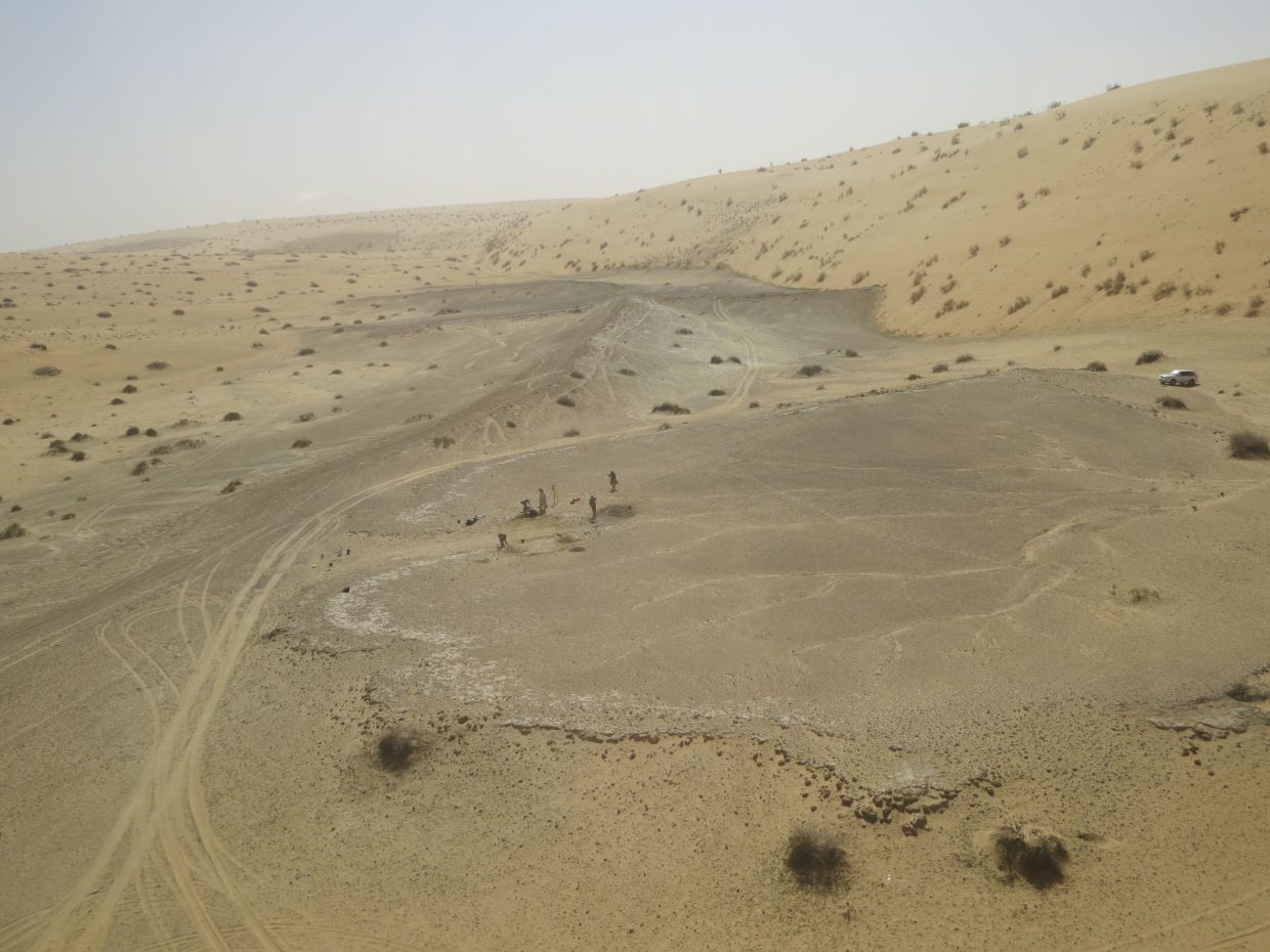 The site of Khall Amayshan 4 in northern Saudi Arabia, where evidence of repeated visits by early humans over the last 400,000 years was found, associated with the remains of ancient lakes. Photo: Palaeodeserts Project via AP/Michael Petraglia