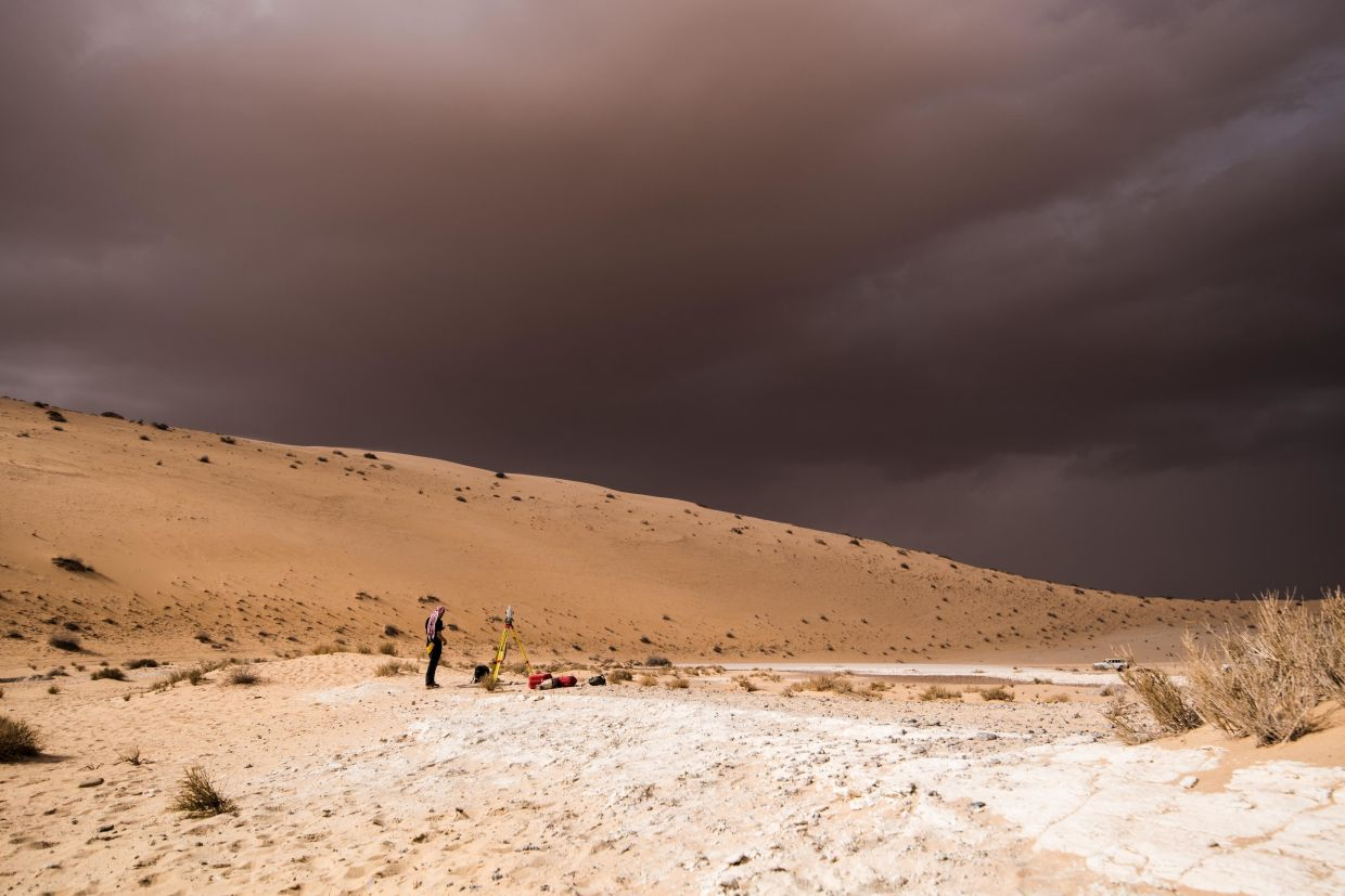 A storm arrives during an archaeological excavation of the remains of an ancient lake in northern Saudi Arabia, where ancient humans lived alongside animals such as hippos. Photo: Palaeodeserts Project via AP/Klint Janulis