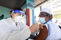 INTERACTIVE: How single-dose Covid-19 vaccines help protect Malaysia's remote communities