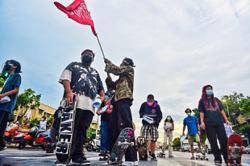 Bangkok protesters skate for democracy