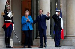Macron, Merkel vow to cooperate closely until new German government is formed