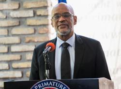 Under scrutiny in murder inquiry, Haiti's PM receives international backing