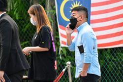 'Datuk Ken' and wife deny using home as gambling den