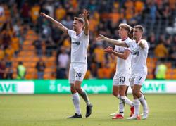 Soccer-Brentford sting Wolves for first top flight away win in 74 years