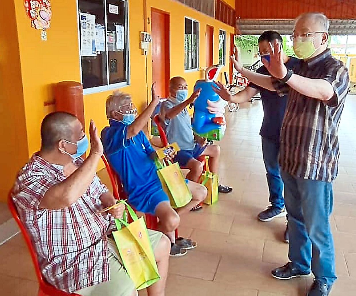 Spreading cheer: Dr Wee spending time with the senior citizens at Rumah Sejahtera Yong Peng.