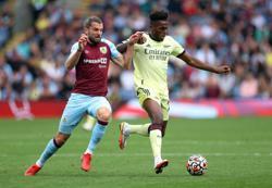 Soccer-Odegaard curler gives Arsenal win at Burnley