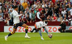 Soccer-Villa end Everton's unbeaten start with 3-0 win
