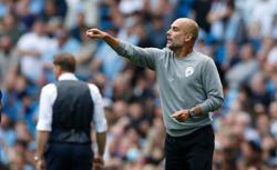 Soccer-No striker, no problem, says Guardiola after Saints stalemate