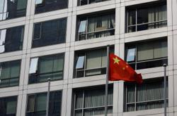 China defends tech crackdown in meeting with Wall Street chiefs