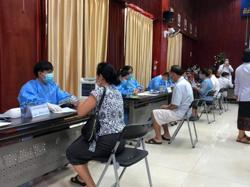 Laos health ministry advises Covid jabs for pregnant women, older students