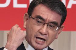 Japan's vaccine czar favoured to become next party leader
