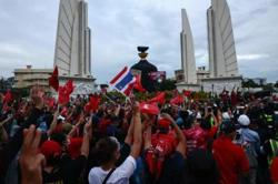 Protesters call to 'kick out' Thai PM on coup anniversary